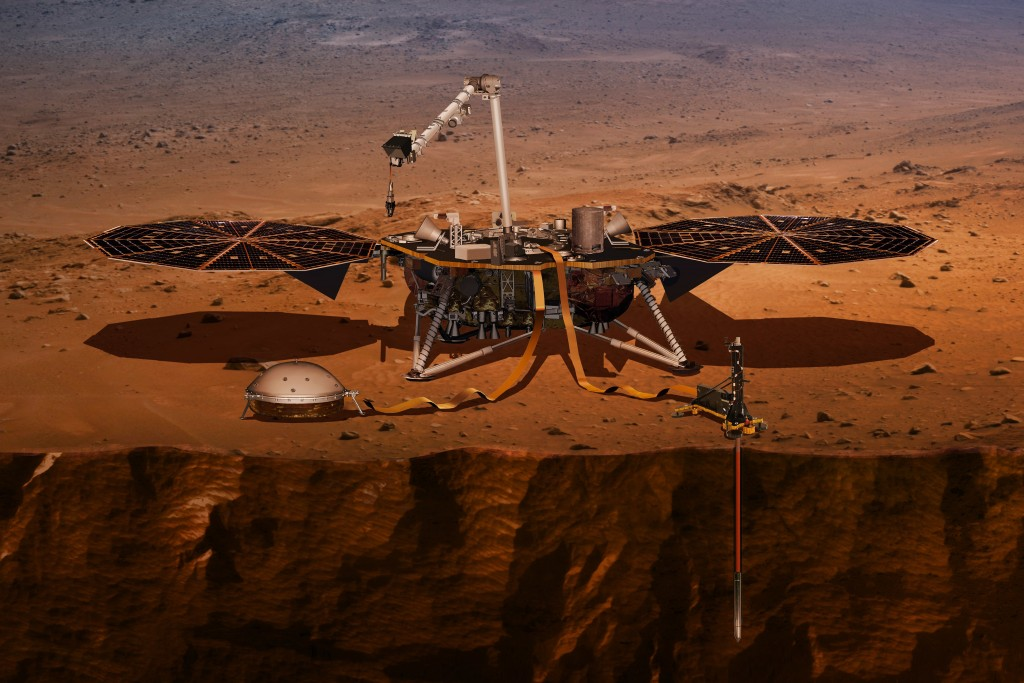 FILE - This illustration made available by NASA in 2018 shows the InSight lander drilling into the surface of Mars. InSight, short for Interior Explor