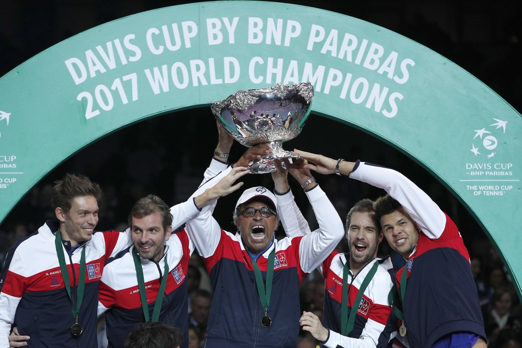 FILE - In this Sunday, Nov. 26, 2017 file photo, French captain Yannick Noah, center, holds the cup after France won the Davis Cup at the Pierre Mauro