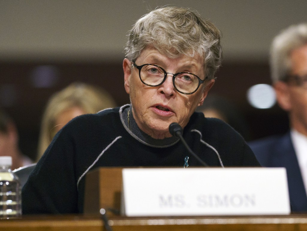 FILE - In this June 5, 2018 file photo, former Michigan State President Lou Anna Simon testifies before a Senate subcommittee in Washington. Simon has