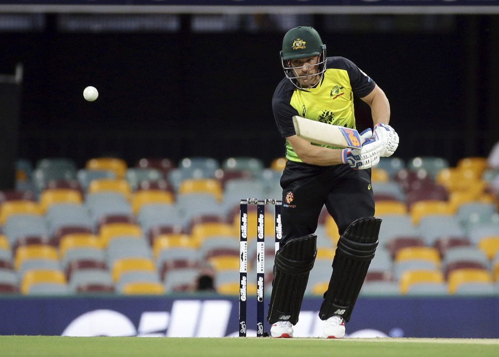 Australia's Aaron Finch plays a shot during the first T20 International cricket match between Australia and India in Brisbane, Australia, Wednesday, N...