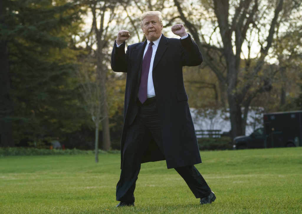 President Donald Trump gestures as he walks to Marine One after speaking to media at the White House in Washington, Tuesday, Nov. 20, 2018, for the sh...