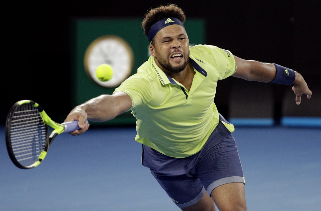 FILE - In this Friday, Jan. 19, 2018 file photo, France's Jo-Wilfried Tsonga reaches for a forehand to Australia's Nick Kyrgios during their third rou