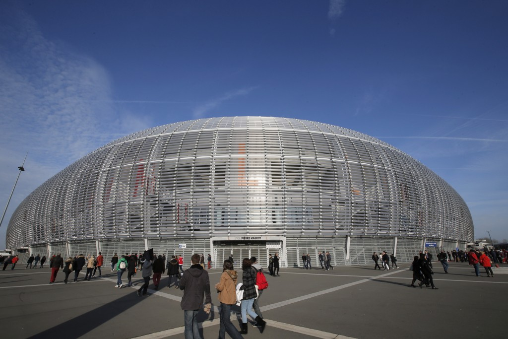 FILE - In this Saturday, Nov. 22, 2014 file photo, people walk outside the Pierre Mauroy stadium, in Lille, northern France. Yannick Noah guided Franc