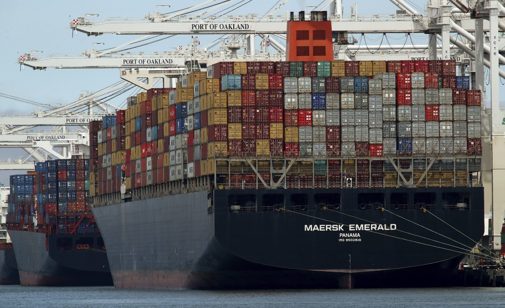 FILE - In this Thursday, July 12, 2018, file photo, the container ship Maersk Emerald is unloaded at the Port of Oakland, Calif. A U.S. government rep...