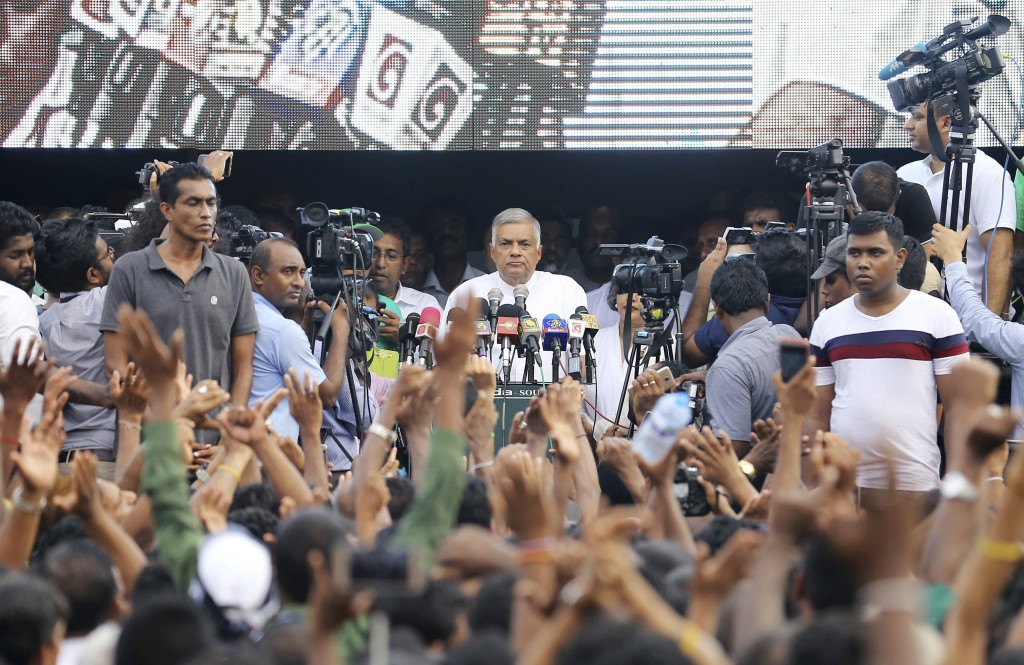 FILE - In this Nov. 15, 2018 file photo, ousted Prime Minister Ranil Wickremesinghe addresses supporters in Colombo, Sri Lanka. Two men each claim to