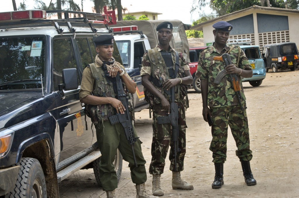 Kenyan police stand guard inside the compound of the command centre that is directing operations in the search for kidnapped Italian volunteer Silvia ...