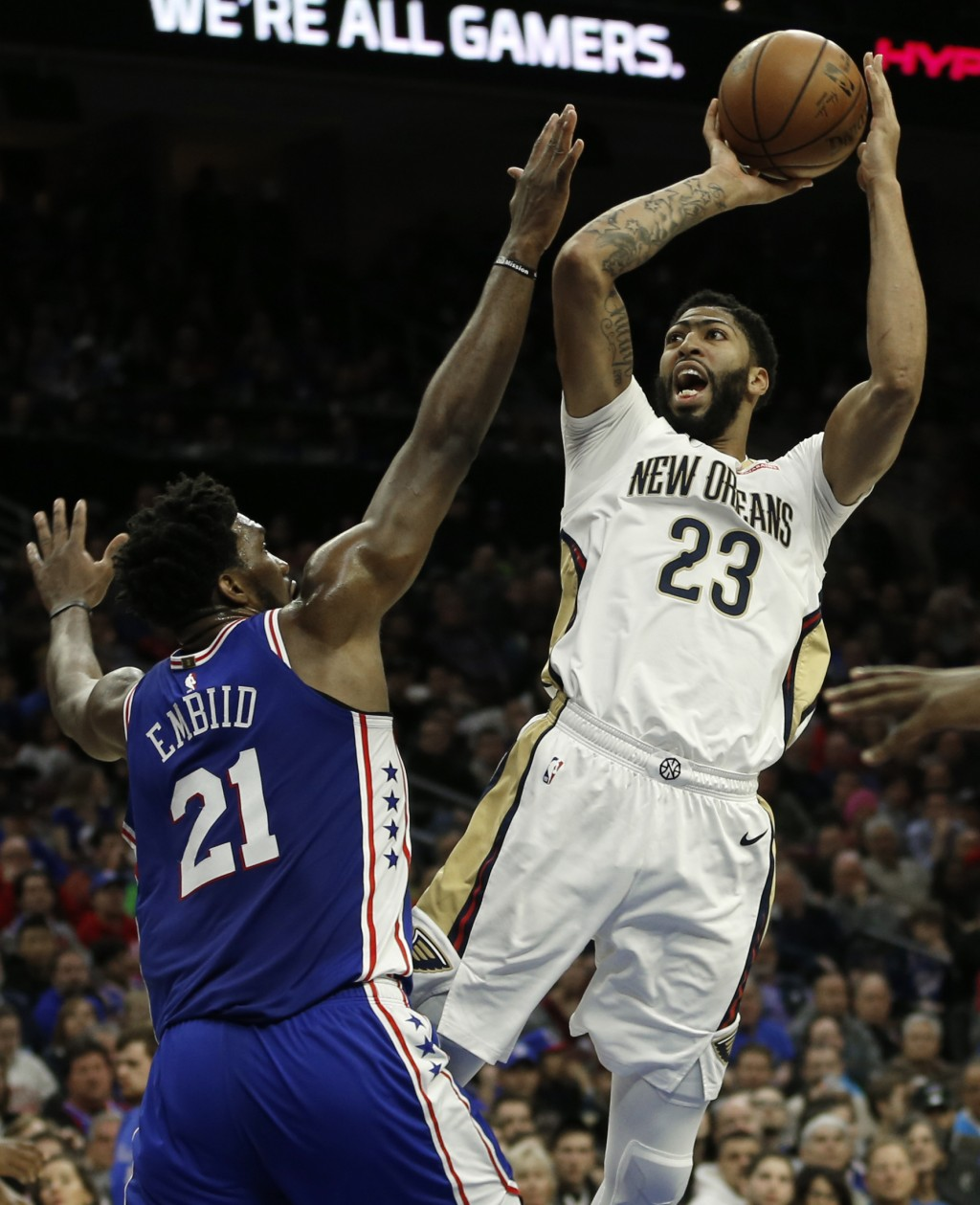 New Orleans Pelicans forward Anthony Davis (23) takes a shot over Philadelphia 76ers center Joel Embiid (21) in the first half on an NBA basketball ga...
