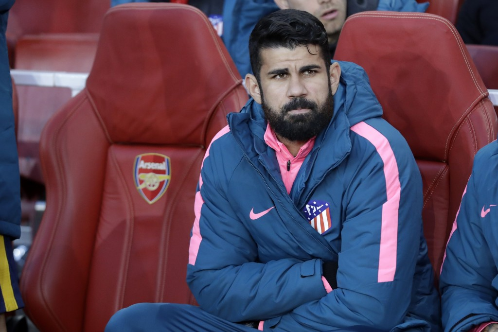 FILE - In this Thursday, April 26, 2018 file photo, Altetico's Diego Costa sits on the bench before the Europa League semifinal first leg soccer match