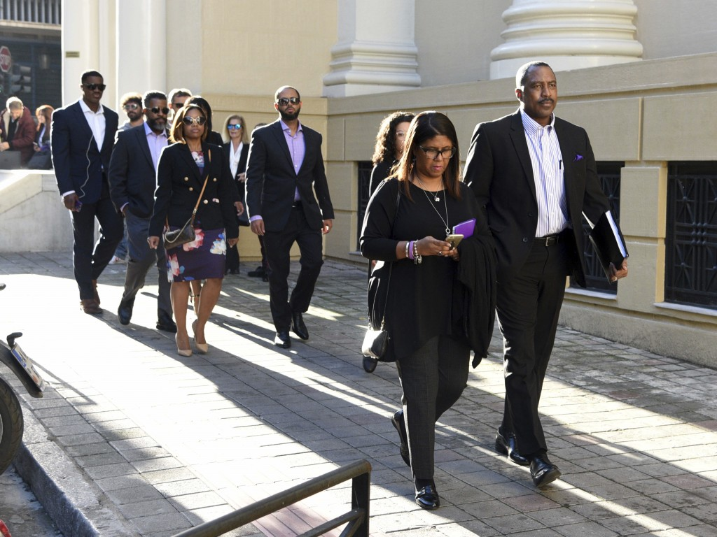 Phil and Jill Henderson, front, parents of Bakari Henderson, arrive at the court house in Patras, Greece, on Thursday, Nov. 22, 2018. A Greek court on...