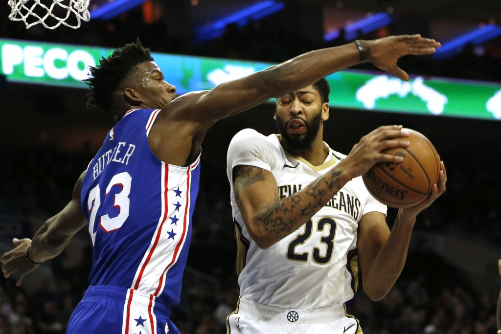 Philadelphia 76ers guard Jimmy Butler (23) blocks a shot by New Orleans Pelicans forward Anthony Davis (23) in the first half on an NBA basketball gam...