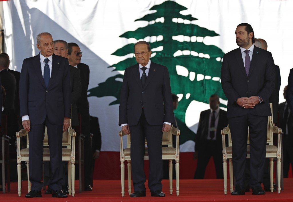 Lebanese President Michel Aoun, center, Lebanese Prime Minister Saad Hariri, right, and Lebanese Parliament Speaker Nabih Berri, left, attend a milita