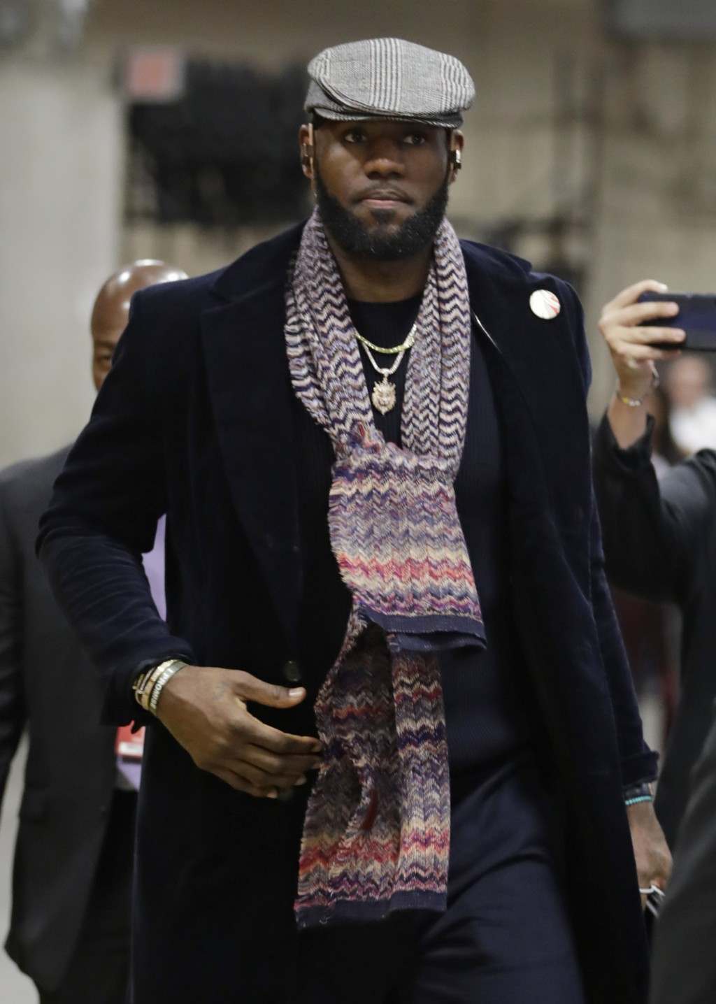 Los Angeles Lakers' LeBron James enters the arena before an NBA basketball game against the Cleveland Cavaliers, Wednesday, Nov. 21, 2018, in Clevelan...