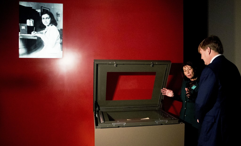 Dutch King Willem-Alexander, right, looks at Anne Frank's diary, displayed in the new Diary Room at the renovated Anne Frank House Museum in Amsterdam...