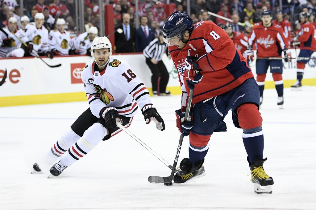 Chicago Blackhawks center Marcus Kruger (16) battles for the puck against Washington Capitals left wing Alex Ovechkin (8), of Russia, during the first...