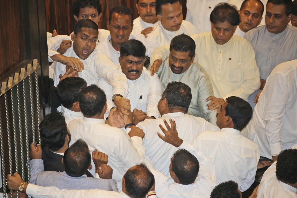 FILE - In this Nov. 15, 2018 file photo, Sri Lankan Lawmakers fight in the parliament chamber in Colombo, Sri Lanka. Two men each claim to be the prim...