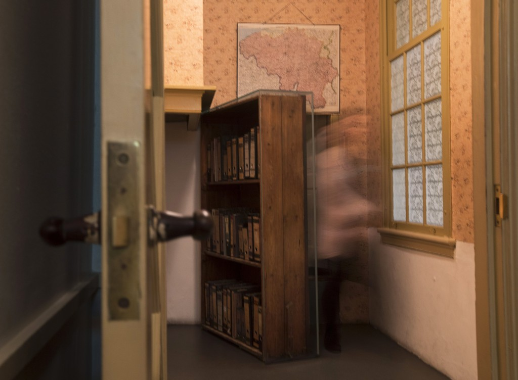 A museum employee emerges from the secret annex at the renovated Anne Frank House Museum in Amsterdam, Netherlands, Wednesday, Nov. 21, 2018. The muse