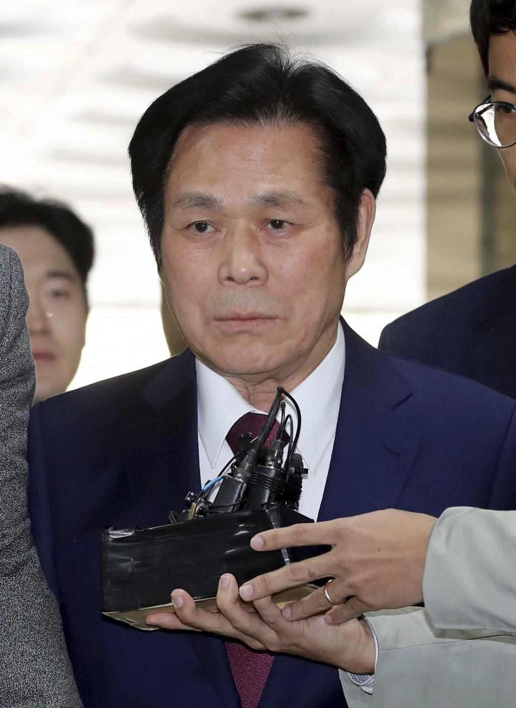 In this May 3, 2018 photo, A South Korean pastor Lee Jae-rock arrives for hearing at the Seoul Central District Court in Seoul, South Korea. Lee has b...