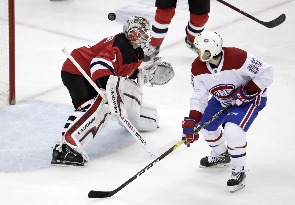 A shot by Montreal Canadiens left wing Max Domi, not pictured, gets by New Jersey Devils goaltender Keith Kinkaid (1) for a goal as Canadiens' Andrew ...