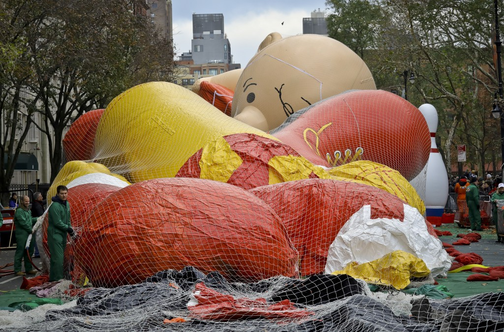 Giant character balloons, including Charlie Brown, are being inflated the night before their appearance in the 92nd Macy's Thanksgiving Day parade, We