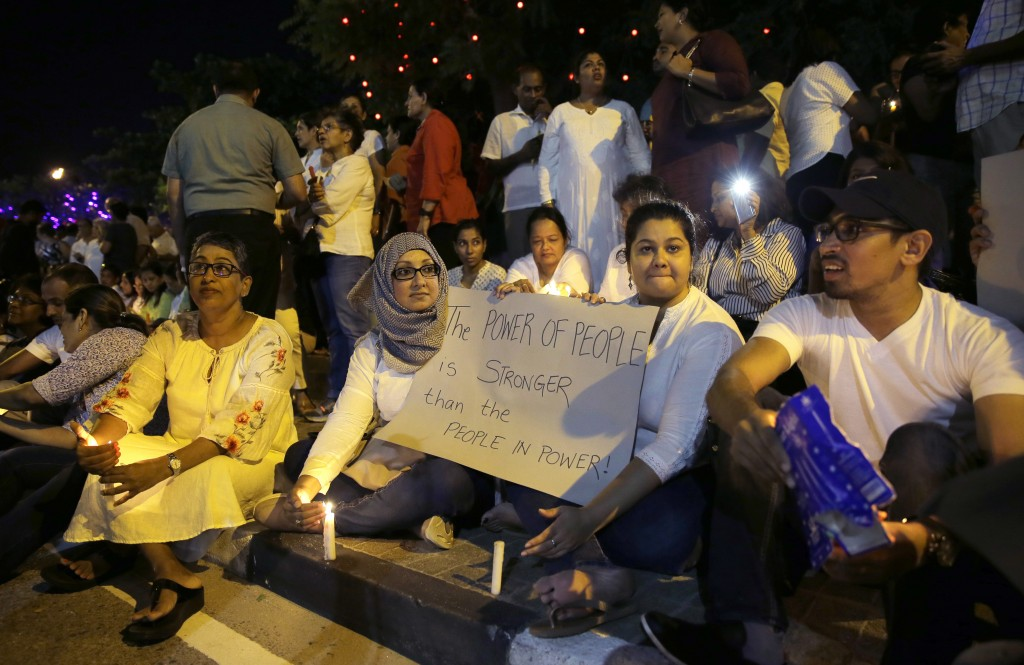 FILE - In this Nov. 11, 2018 file photo, Pro- democratic Sri Lankans take part in a candle light vigil, in Colombo, Sri Lanka. Two men each claim to b