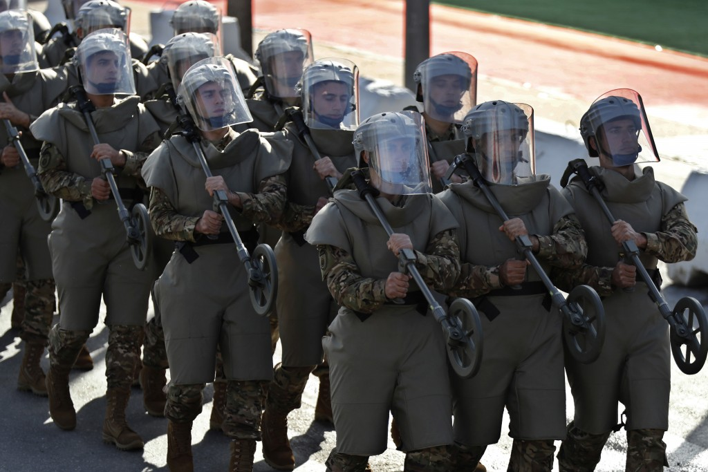 Lebanese soldiers from an explosives unit, march during a military parade to mark the 75th anniversary of Lebanon's independence from France, in downt...