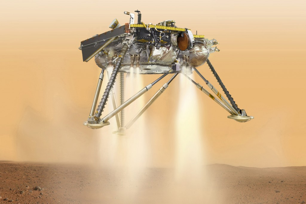 This illustration made available by NASA in October 2016 shows an illustration of NASA's InSight lander about to land on the surface of Mars. NASA's I...