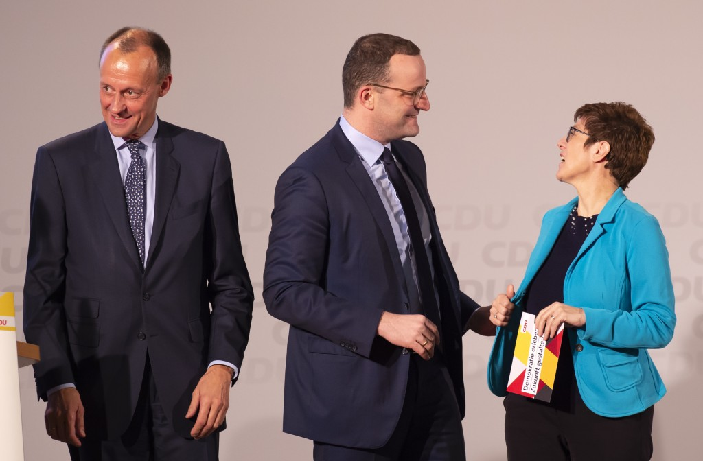 FILE - In this Nov. 21, 2018 file photo Friedrich Merz, former CDU faction leader, left, Germany's Health Minister Jens Spahn, center, and Annegret Kr...
