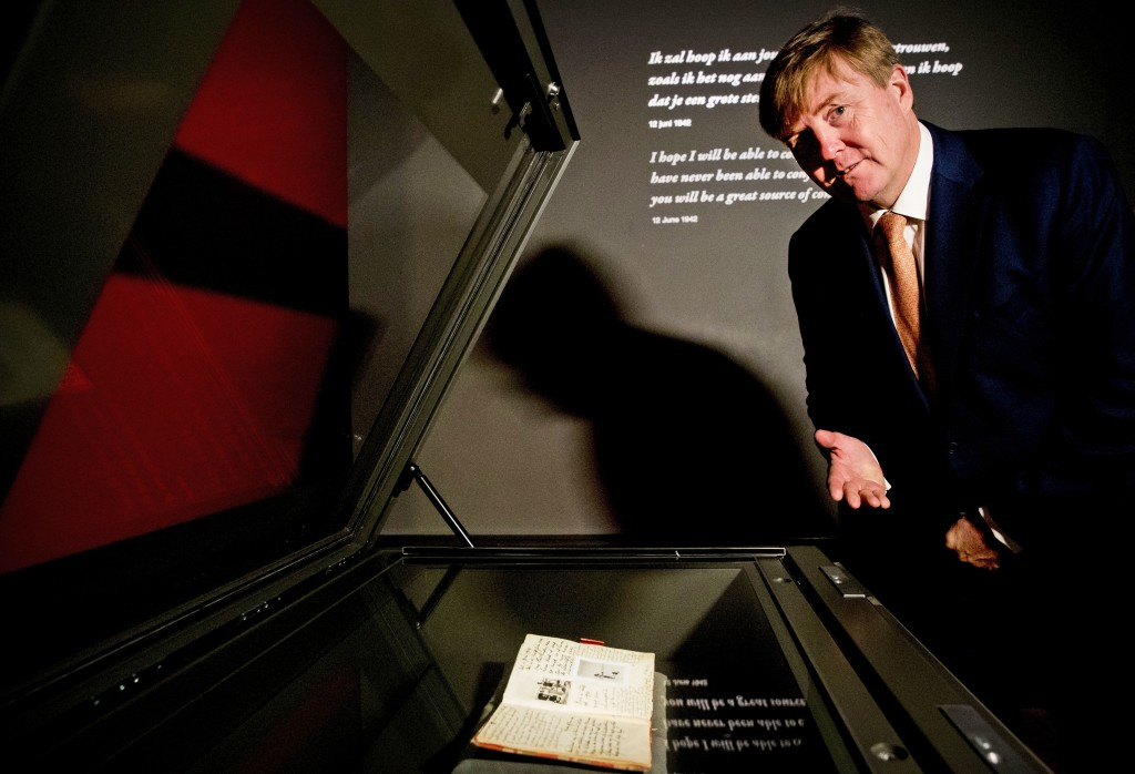 Dutch King Willem-Alexander looks at Anne Frank's diary displayed in the new Diary Room at the renovated Anne Frank House Museum in Amsterdam, Netherl...