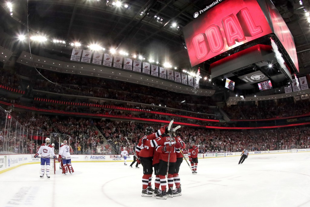 New Jersey Devils center Pavel Zacha (37), of the Czech Republic, celebrates his goal on the Montreal Canadiens with teammates during the second perio...