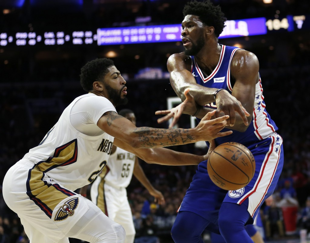 New Orleans Pelicans forward Anthony Davis (23) knocks the ball away from Philadelphia 76ers center Joel Embiid (21) during the second half on an NBA ...