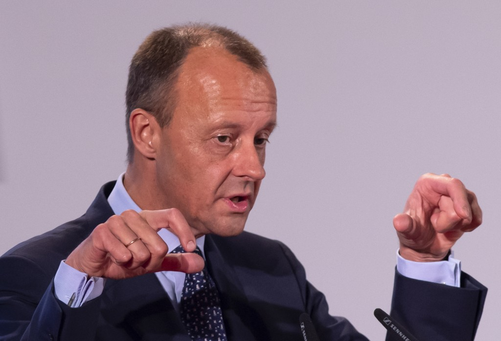 In this Nov. 21, 2018 photo Friedrich Merz, former CDU faction leader, gestures during his speech at the CDU regional conference to present his concep...