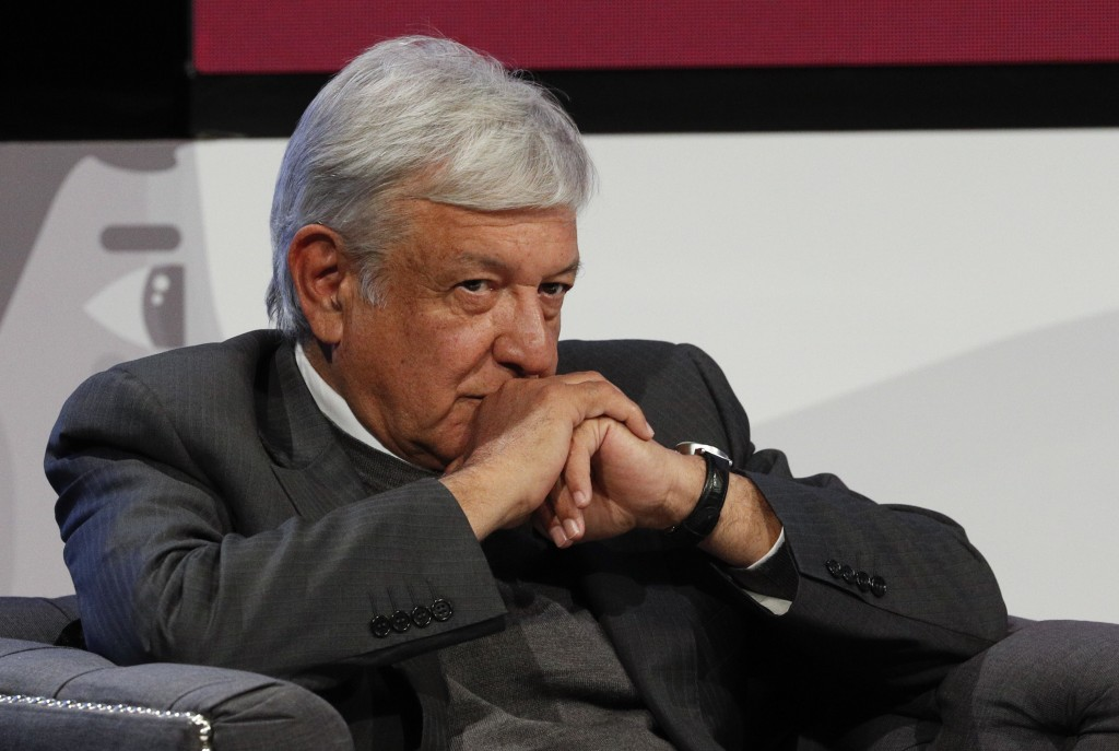 Mexican President-elect Andres Manuel Lopez Obrador listens during a meeting with Ricardo Salinas and other business leaders in Mexico City, Thursday,