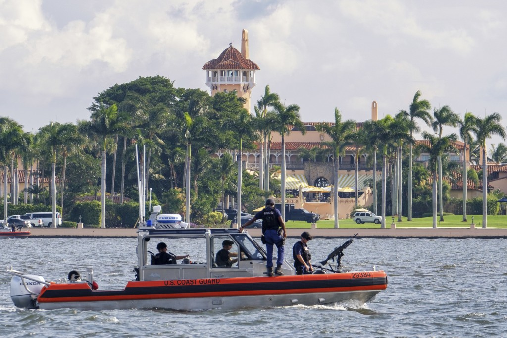The U.S. Coast Guard patrol boat passes President Donald Trump's Mar-a-Lago estate in Palm Beach, Fla., Thursday, Nov. 22, 2018. President Trump made