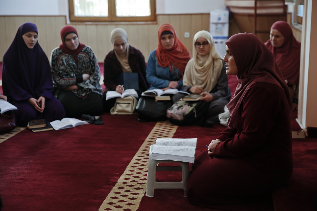 Agime Sogojeva, 2nd from right, a professor of Islamic studies holds a class inside the Haxhi Veseli mosque in the northern Kosovo town of Mitrovica o
