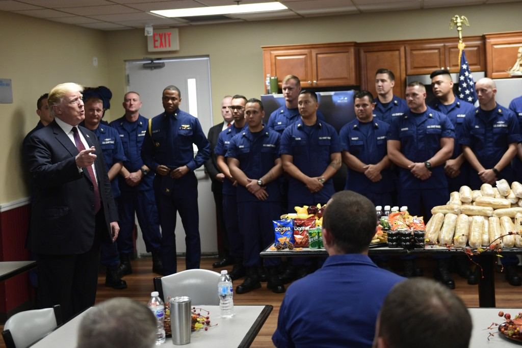 President Donald Trump meets with members of the U.S. Coast Guard stationed at United States Coast Guard Station Lake Worth Inlet in Riviera Beach, Fl