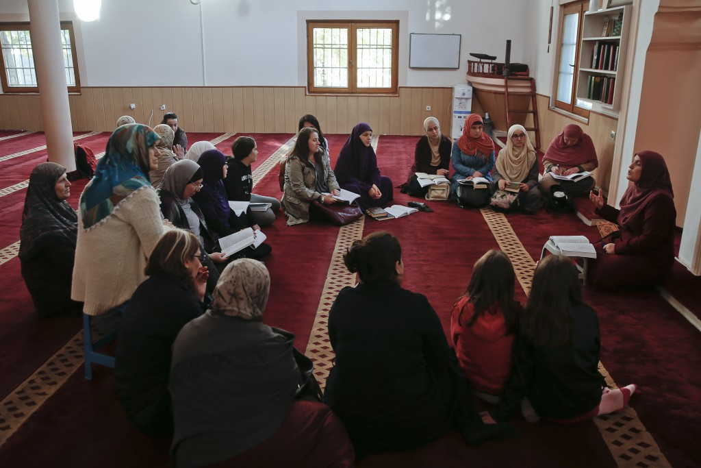 Agime Sogojeva a professor of Islamic studies holds a class inside the Haxhi Veseli mosque in the northern Kosovo town of Mitrovica on Monday, Nov. 12