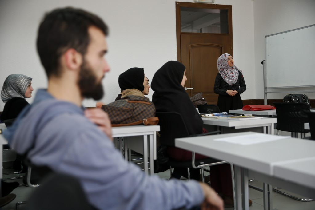 Rineta Nitaj, a 2nd year bachelor student at the Faculty of Islamic Studies in Kosovo presents her work during an English class in Kosovo capital Pris
