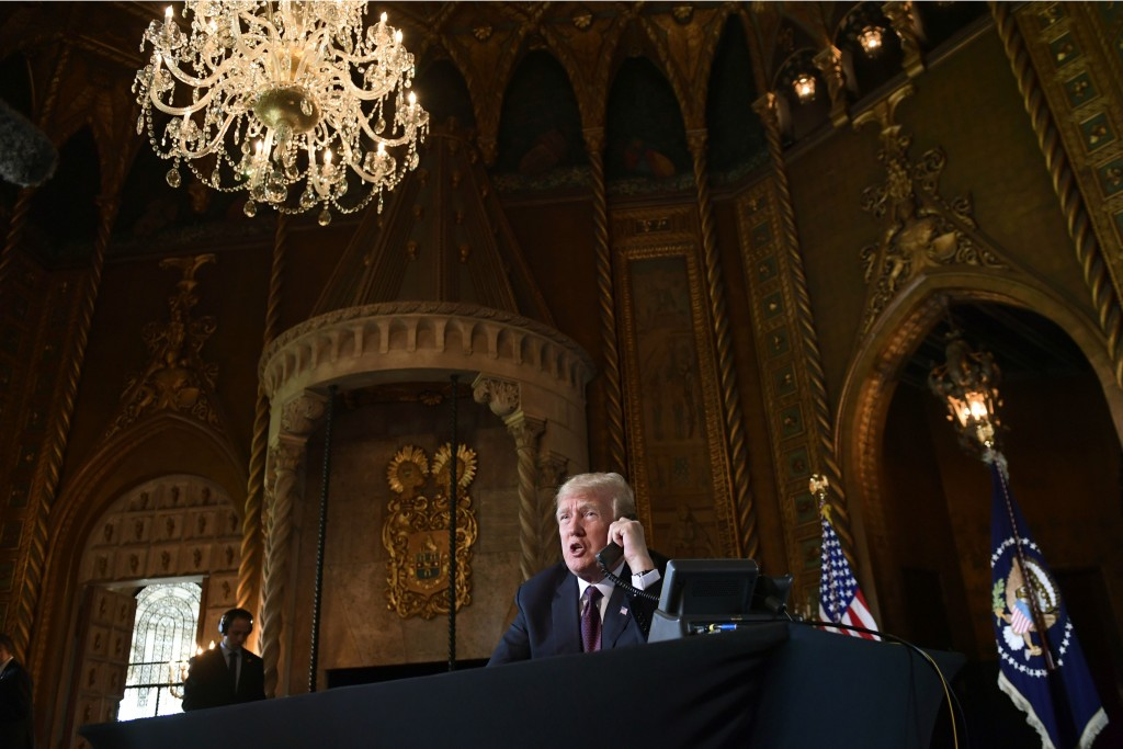 President Donald Trump talks with troops via teleconference from his Mar-a-Lago estate in Palm Beach, Fla., Thursday, Nov. 22, 2018. (AP Photo/Susan W