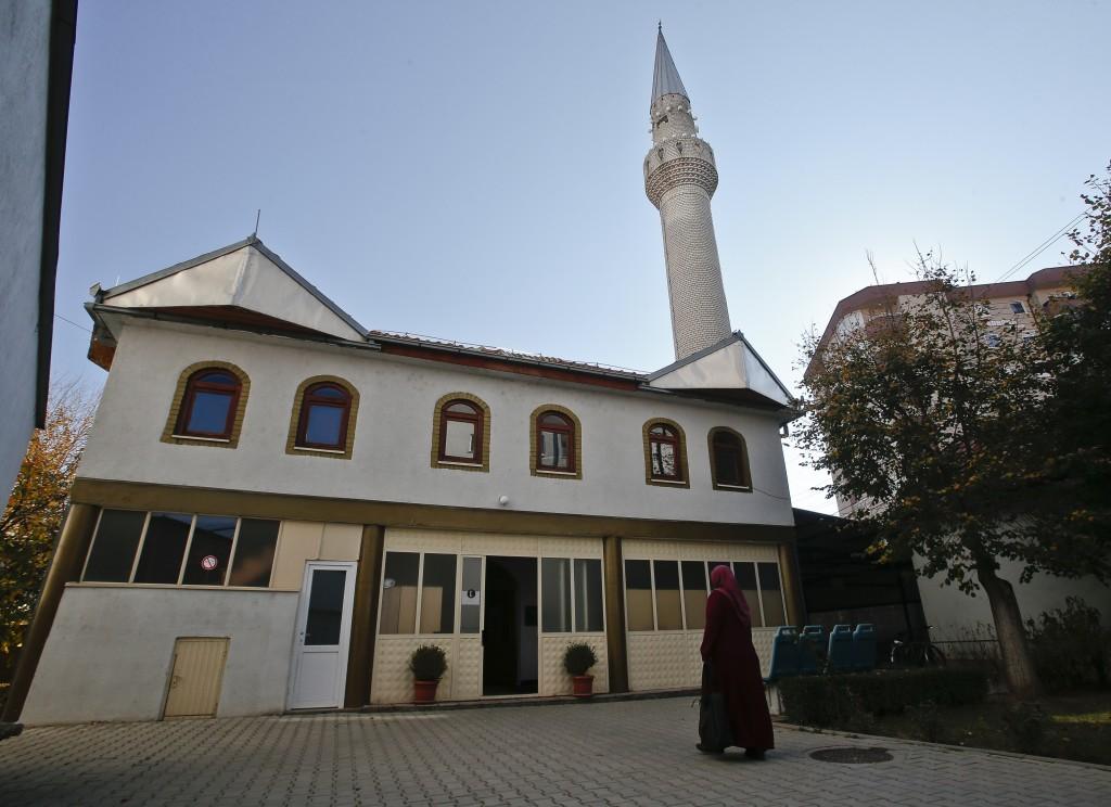 Agime Sogojeva, a professor of Islamic studies enters the Haxhi Veseli mosque in the northern Kosovo town of Mitrovica on Monday, Nov. 12, 2018.  In K