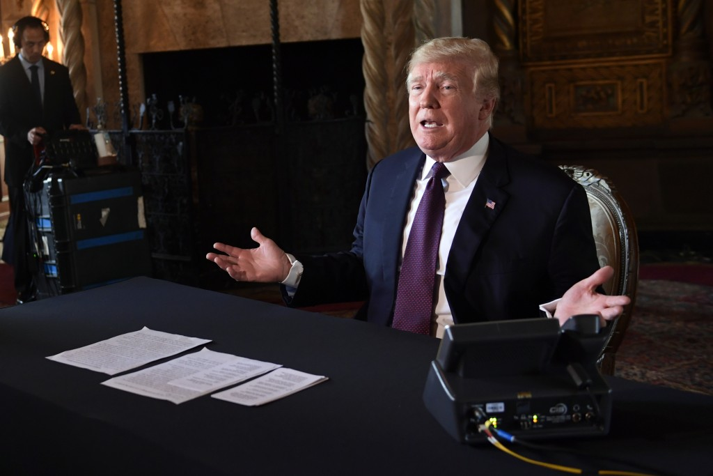 President Donald Trump speaks to reporters following his teleconference with troops from his Mar-a-Lago estate in Palm Beach, Fla., Thursday, Nov. 22,