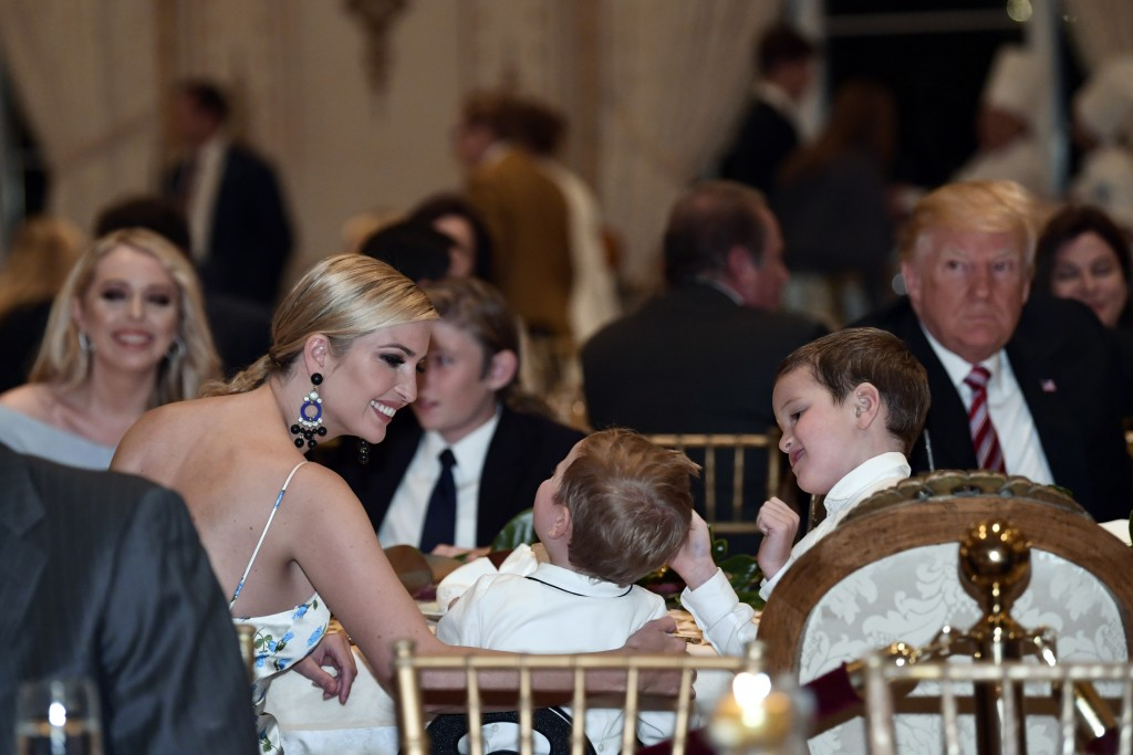 Ivanka Trump talks with her kids as she has Thanksgiving Day dinner at their Mar-a-Lago estate in Palm Beach, Fla., Thursday, Nov. 22, 2018, with Pres