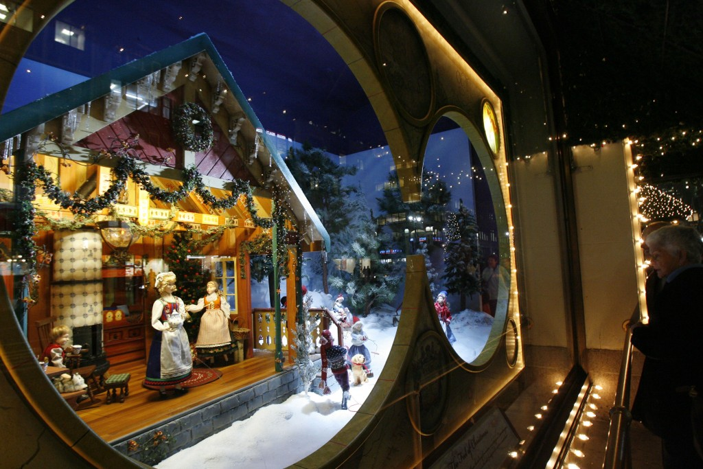 FILE- In this Nov. 14, 2007 file photo, pedestrians peer into Lord & Taylor's holiday window display at the retailer's flagship store in New York. For