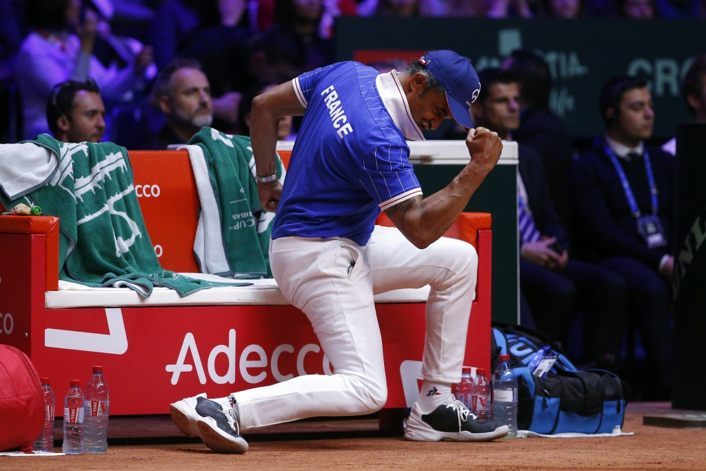 France's team captain Yannick Noah clenches his fist during the Davis Cup final between France and Croatia, Saturday, Nov. 24, 2018 in Lille, northern...