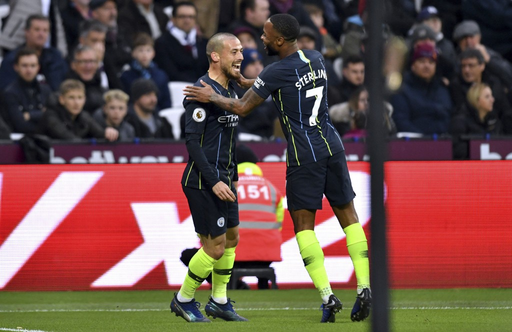 Manchester City's David Silva, left, celebrates scoring his side's first goal of the game with team mate Raheem Sterling during their English Premier