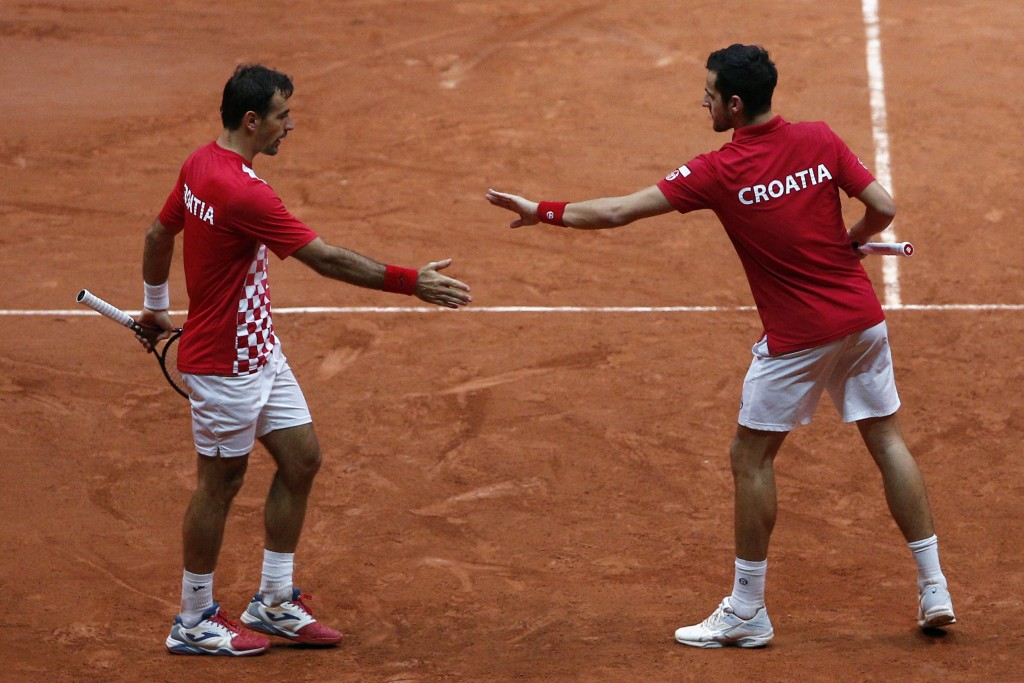 Croatia's Ivan Dodig, left, and Mate Pavic in their Davis Cup final between France and Croatia, Saturday, Nov. 24, 2018 in Lille, northern France. Cro...