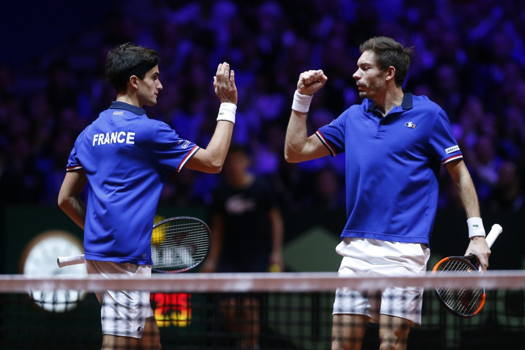 France's Nicolas Mahut, right, and Pierre Hughes Herbert celebrate after scoring a point during the Davis Cup final between France and Croatia, Saturd...
