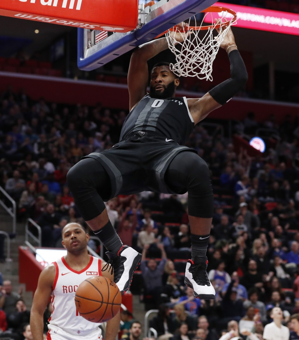 Detroit Pistons center Andre Drummond dunks as Houston Rockets guard Eric Gordon watches during the first half of an NBA basketball game Friday, Nov.