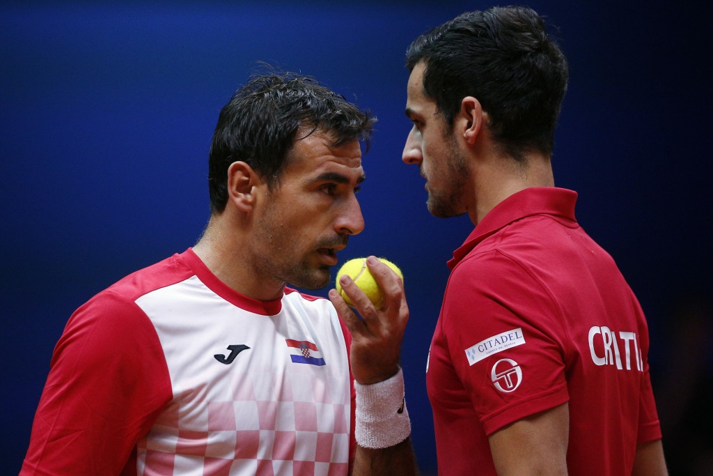 Croatia's Ivan Dodig, left, and Mate Pavic talk during the Davis Cup final between France and Croatia, Saturday, Nov. 24, 2018 in Lille, northern Fran...