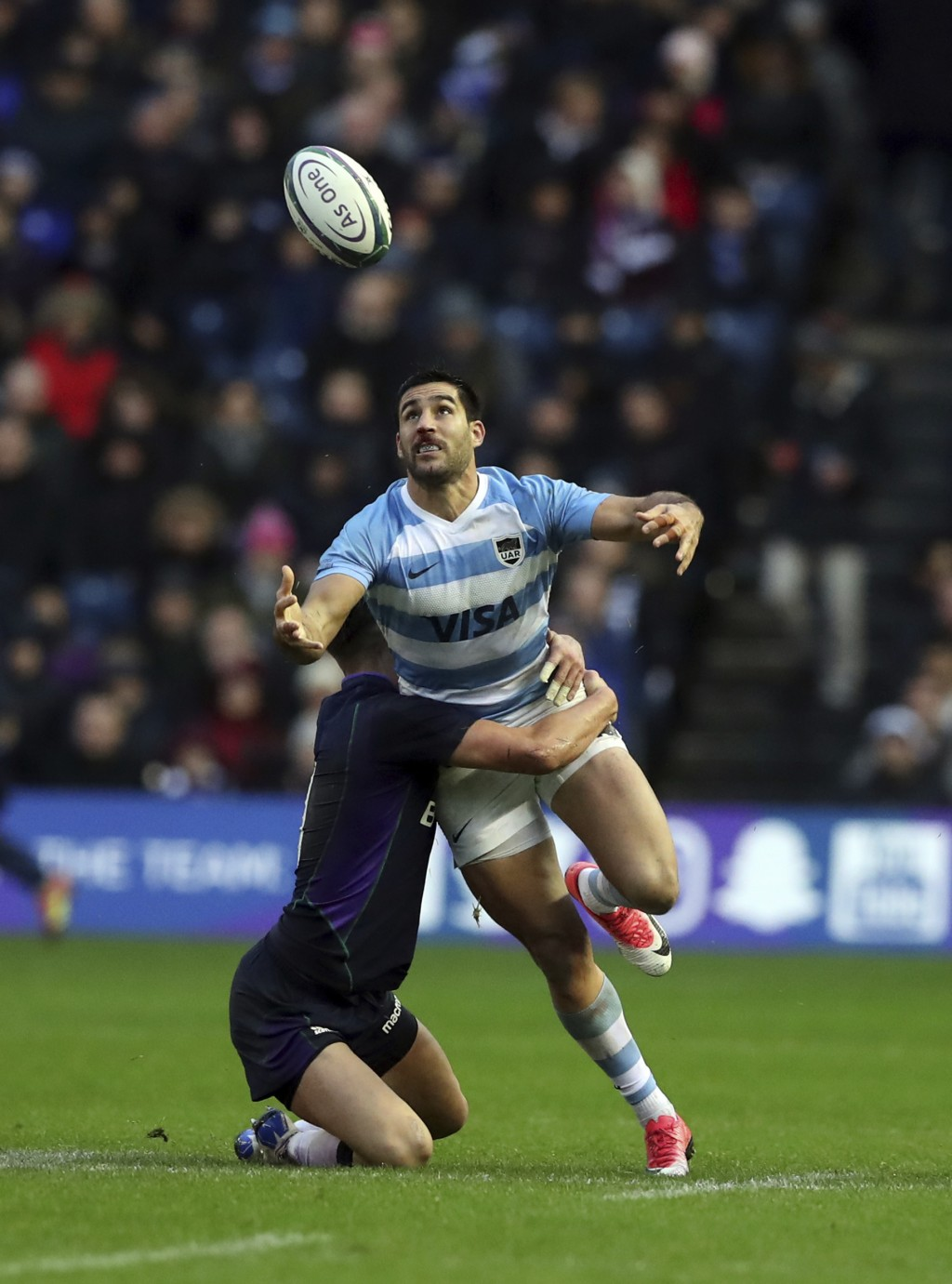 Argentina's Bautista Ezcurra, right, is tackled by Scotland's Adam Hastings during the rugby union international match between Scotland and Argentina ...