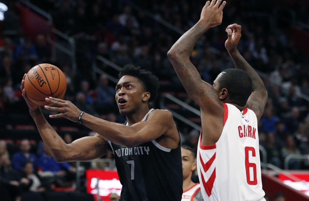 Detroit Pistons forward Stanley Johnson makes a layup as Houston Rockets forward Gary Clark (6) defends during the first half of an NBA basketball gam